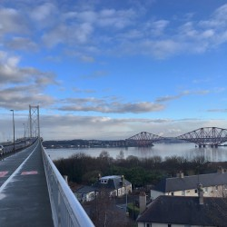 View northwards of the Forth road and rail bridges from the road bridge in the crisp morning sun
