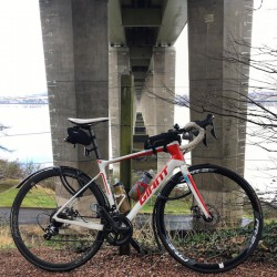 Giant road bike under the Tay Road Bridge