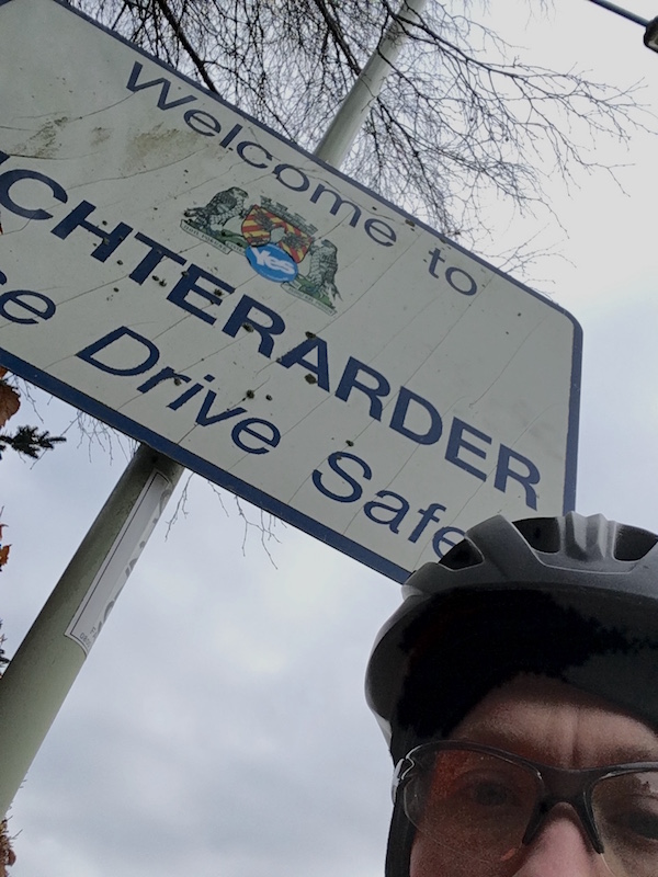 Me at the Auchterarder sign during the Forth and Tay Audax