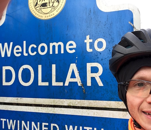 Me at the sign for Dollar during the Forth and Tay Audax