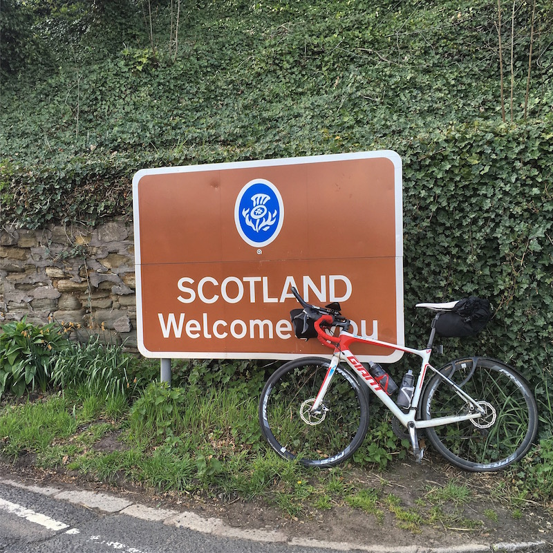 Giant bike next to Welcome to Scotland sign at Coldstream during the 2018 Merse and Moors Audax
