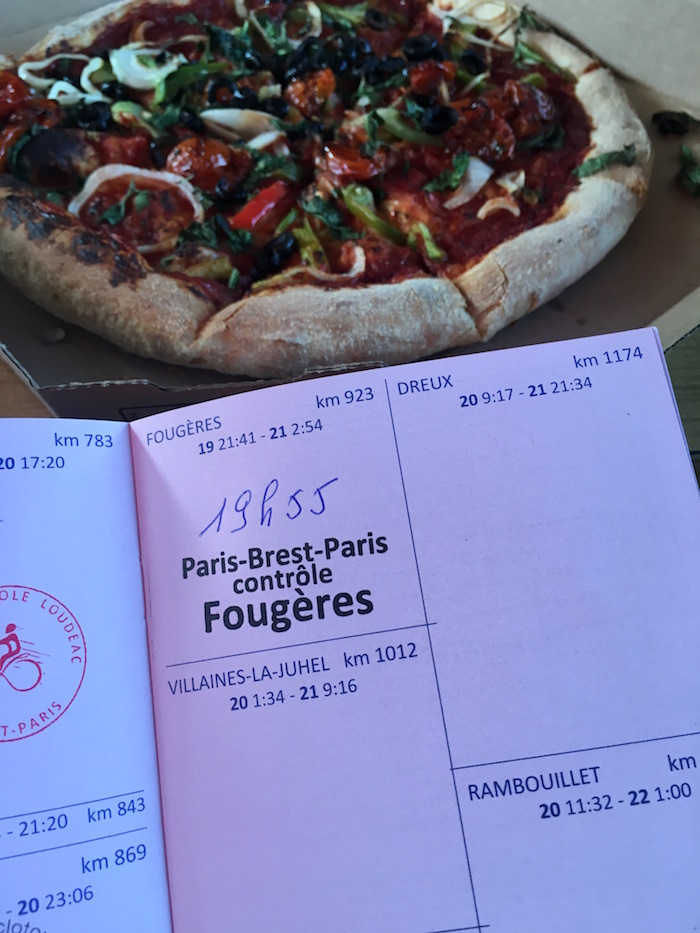 Pizza and brevet card stamp at Fourgeres during Paris Brest Paris 2019